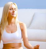 Young Woman Sitting in Meditation Stock Images