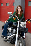 Young Woman Sitting on Motorcycle Royalty Free Stock Images