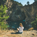 Young woman sitting near bay, Antiocheia Ad Cragum ancient town Royalty Free Stock Photos