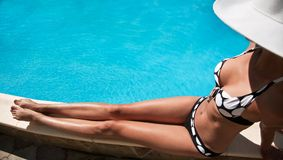 Young woman sitting near pool. Stock Photography