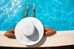 Young woman sitting near pool. Royalty Free Stock Images
