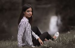 Young Woman Sitting Near The River Royalty Free Stock Photos