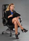 Young woman sitting in office chair Stock Photo
