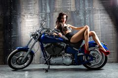 Young Woman Sitting On Motorcycle. Stock Photography