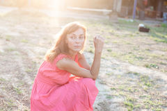 Young woman sitting outdoors at sunset Royalty Free Stock Photography