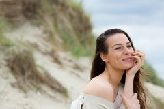 Young woman sitting outdoors thinking Royalty Free Stock Photography