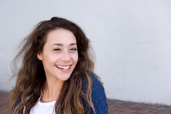 Young woman sitting outside laughing Stock Image