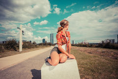 Young woman sitting outside and looking at city Royalty Free Stock Photos