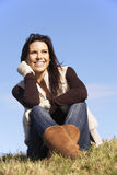 Young Woman Sitting In Park Royalty Free Stock Photos