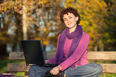Young Woman Sitting on Park Bench Royalty Free Stock Photos