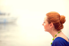 Young woman sitting on a pier Royalty Free Stock Photos