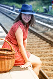 Young woman sitting on platform at train station Royalty Free Stock Photography