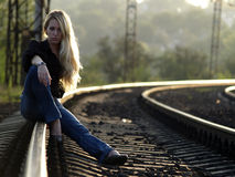 Young woman sitting on rail Royalty Free Stock Photography