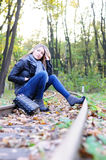 Young woman sitting on a railroad Stock Photography