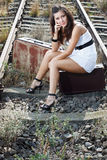 Young woman sitting on railroad Royalty Free Stock Photography