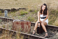 Young woman sitting on railroad Royalty Free Stock Image
