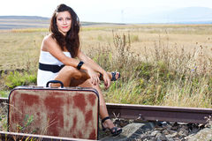 Young woman sitting on railroad Stock Images