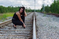 Young woman sitting on a railroad Royalty Free Stock Photo