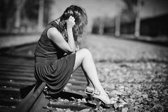 Young woman sitting on a rails Stock Photo