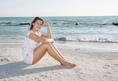 Young Woman, Sitting Relaxed On The Beach Royalty Free Stock Photography