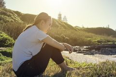 Young woman sitting and relaxing in morning sun Royalty Free Stock Images