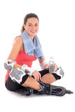 Young woman sitting with rollers on legs and bottle of water Royalty Free Stock Images