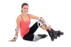 Young woman sitting with rollers on legs Royalty Free Stock Photography