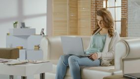 Young woman sitting in room with laptop, bad news, breakup. Stock footage stock video