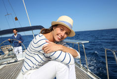 Young woman sitting on sailing boat cruising Stock Photos
