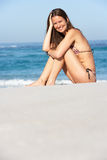 Young Woman Sitting On Sandy Beach Stock Photos