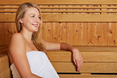 Young woman sitting in sauna Stock Photo