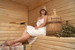 Young woman is sitting at sauna bath Stock Photography