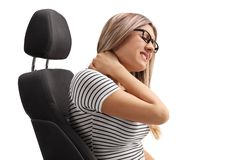 Young woman sitting in a seat and experiencing neck pain royalty free stock photo