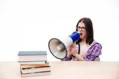 Young woman sitting and shouting in megaphone Royalty Free Stock Photography