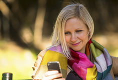 Young woman sitting with smartphone Stock Photos