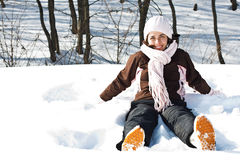 Young woman sitting in snow Stock Photography