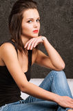 Young woman sitting on a sofa Royalty Free Stock Photography