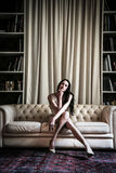 Young woman sitting on a sofa Royalty Free Stock Photos