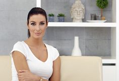 Young woman sitting on sofa at home Royalty Free Stock Photo