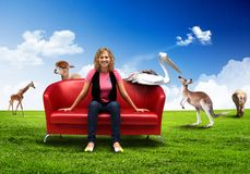Young woman sitting on sofa nature background Royalty Free Stock Images