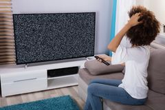 Woman Sitting Near Television With No Signal stock image