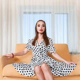 Young woman sitting on sofa Royalty Free Stock Photos