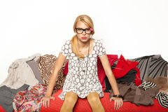 Girl sitting on clothes Royalty Free Stock Photography