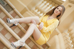 Young  woman sitting on the stair Royalty Free Stock Images