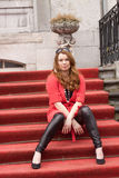 A young woman sitting on the stairs Royalty Free Stock Photography