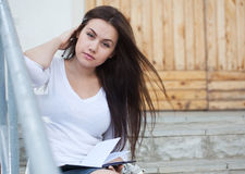 Young woman sitting on the stairs Royalty Free Stock Photo