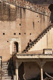 Young woman sitting on the stairs, Bundi Palace, India Stock Images