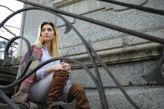 Young woman sitting in a stairs. Royalty Free Stock Images