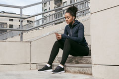 Young woman sitting on stairs after training Stock Images