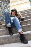 Young woman sitting on stairs Royalty Free Stock Photography